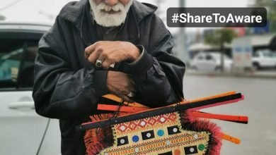 Photo of Old Man Who Sells Handmade Fans Made By Her Daughter